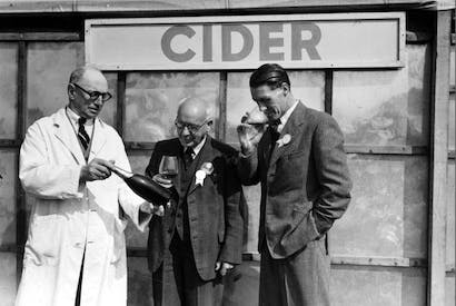 The shape of that bottle looks familiar: cider judging, Bath, 1950