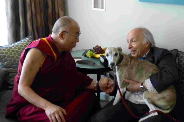 Jonathan Mirsky and his whippet, Iris, with the Dalai Lama