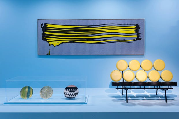 Installationat 'Pop Art Design'exhibition, showing Roy Lichtenstein's 'Yellow Brushstroke II', 1965, plates by Eduardo Paolozzi (c.1972) and Ettore Sottsass (1958) and 'Marshmallow' sofa, 1956, by George Nelson Associates