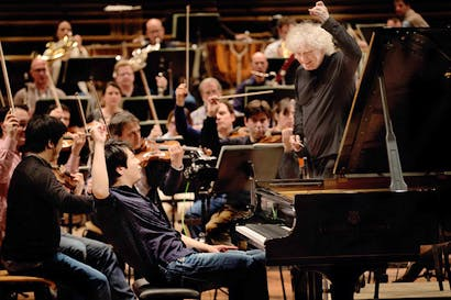 This charming man: Lang Lang rehearsing with Sir Simon Rattle and the Berlin Philharmonic