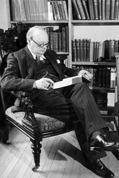 Churchill reading in his library at Chartwell