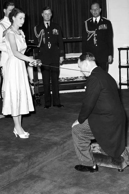 Sword of honour: Queen Elizabeth II knights Sir Garfield Barwick at Government House in Sydney, 6 February 1954, during her royal tour of Australia