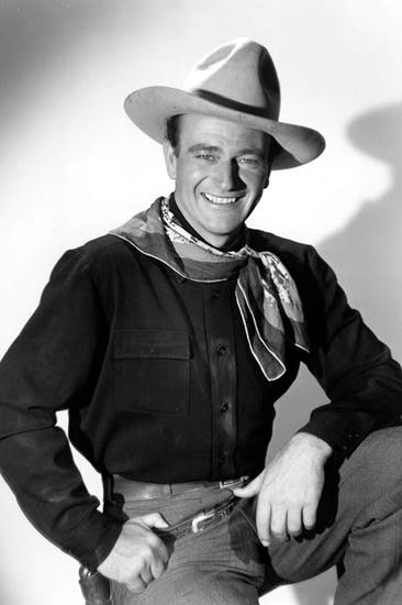 A boy named Marion: John Wayne pictured on the set of Stagecoach (1939)