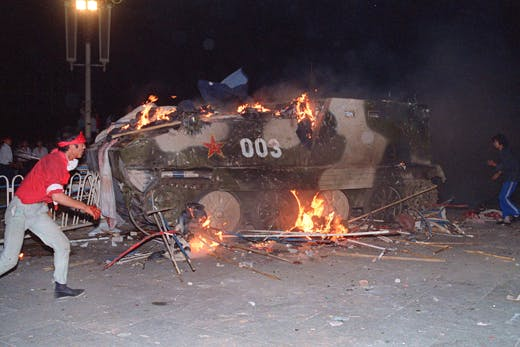 An armoured personnel carrier is in flames as stud