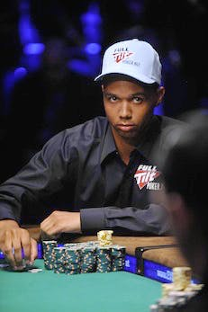 Phil Ivey pauses during a hand at the fi