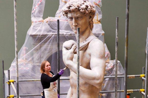 Conservator Johanna Puisto dusts the cast of Michelangelo's 'David' post-conservation, November 2014