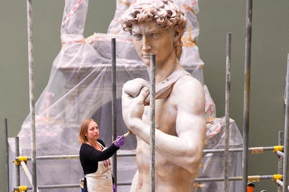 Conservator Johanna Puisto dusts the cast of Michelangelo's 'David' post-conservation, November 2014