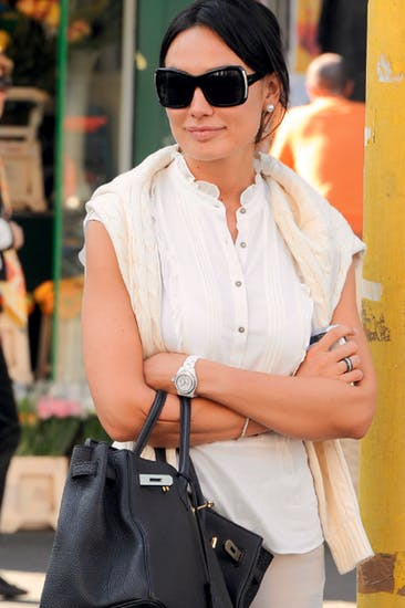 Nicole Minetti (with statutory sunglasses) in Milan in 2011. The bunga-bunga girl, catapulted into politics by Berlusconi, was accused of aiding and abetting prostitution and submitting fraudulent expenses