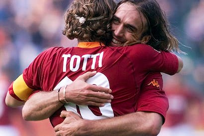 Why do footballers hug each other when a goal is scored? It's all to do with grooming