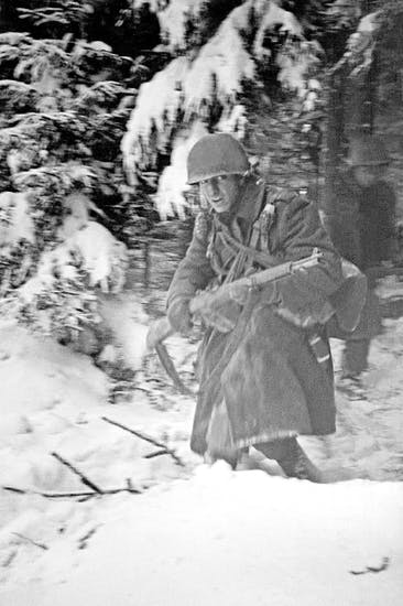 Out of the woods: American forces attack a German machine gun post, December 1944. The grim determination of the Allies, whose heroism kept the Germans at bay, helped pave the way for the final Russian advance on Berlin