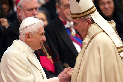 Pope Emeritus Benedict XVI is greeted by Pope Francis during the Ordinary Public Consistory at St. Peter's Basilica in February (Photo: Franco Origlia/Getty)