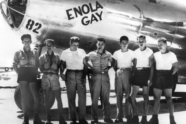 American bomber pilot Paul W. Tibbets Jr. (centre) stands with the ground crew of the bomber 'Enola Gay' which Tibbets flew in the atomic bombing of Hiroshima (Photo: AFP/Getty)