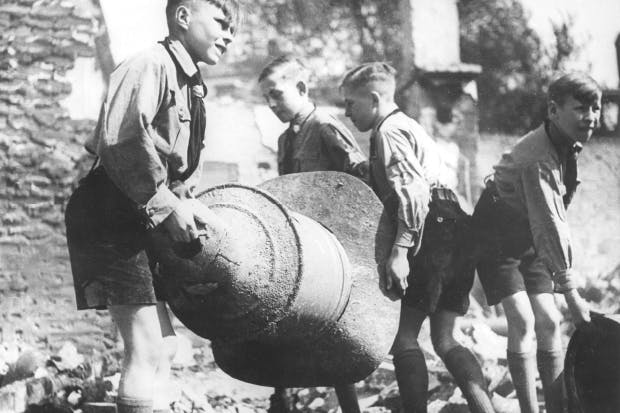 Members of the Hitler Youth clear debris after an air raid on Berlin, August 1944