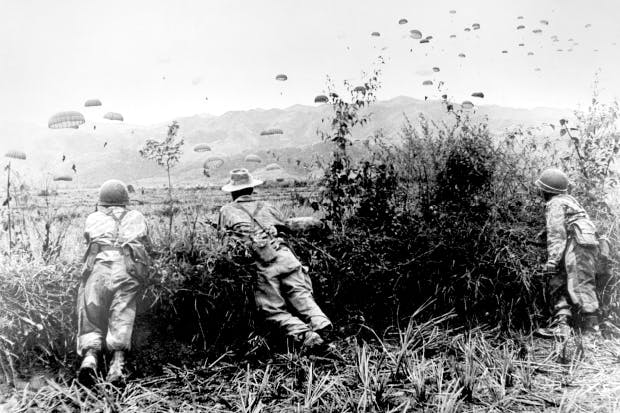 Paratroopers are dropped to reinforce trapped French troops at Dien Bien Phu, 1954