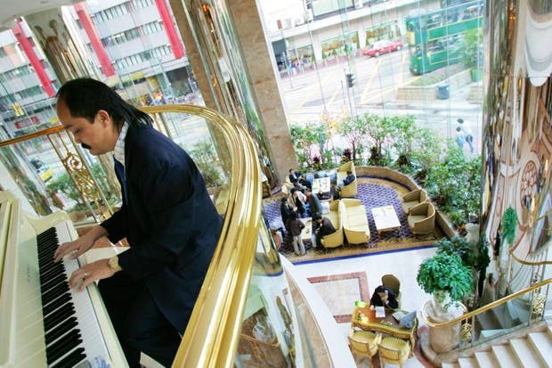 A musician plays in the lobby of the Regal hotel in Hong Kong. Photo: Lucas Schifres/Bloomberg/Getty Images