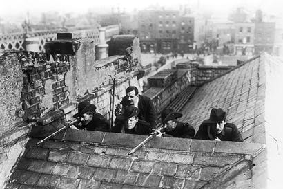 Irish Citizen Army soldiers on rooftops in Dublin before the Easter Rising of 1916