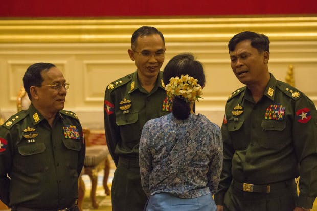 Aung San Suu Kyi with military officials at the swearing-in of President Htin Kyaw, 30 March 2016