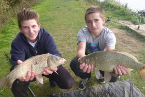 Proud boys with their Fishing4Schools catch.