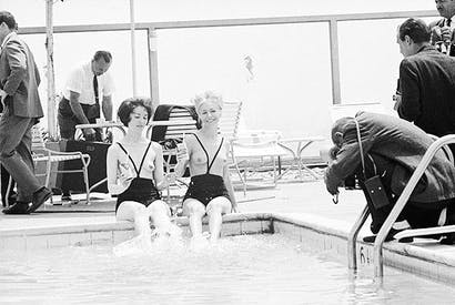 Models wearing the original topless bathing suit by Rudi Gernreich