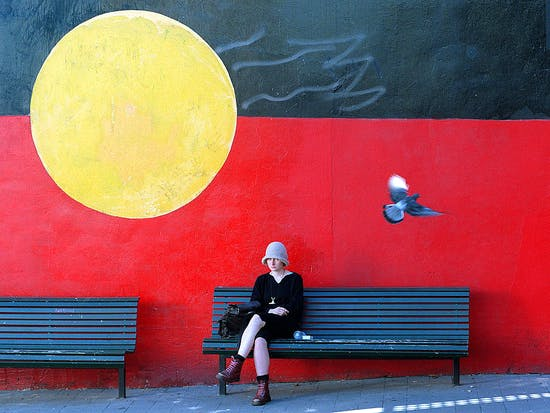 A mural of the Aboriginal flag adorn a w