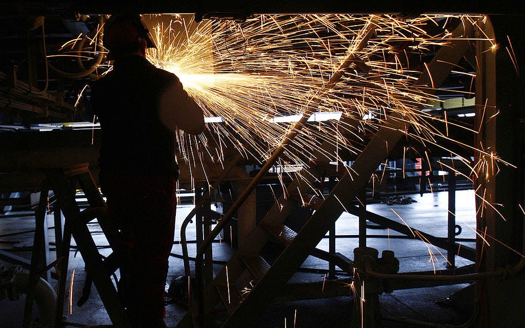 A welder works on the Royal Navy's suppl