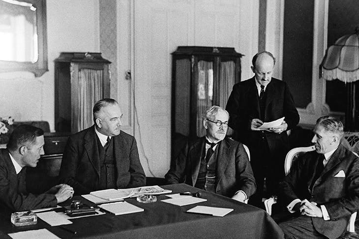 The brisk, implacable Sir Maurice Hankey (second from right) stands between Ramsay Macdonald and Franz von Papen at the Reparations Conference in Lausanne in 1932