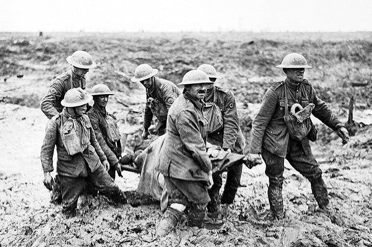 Stretcher-parties wading through the morass sometimes took six hours to bring in casualties. Left: near Boesinghe, 1 August 1917 (from Chris McNabb's Passchendaele 1917)