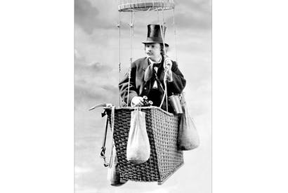 Nadar ascending aloft in his basket — in this case in his studio, recording the event for mass consumption