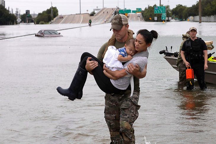 Safe: Catherine Pham and her baby son are rescued in Houston