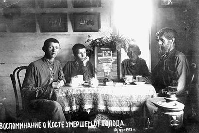 Mykola Bokan's photograph of his family, including a memorial to 'Kostya, who died of hunger', July 1933. Bokan and his son were arrested for documenting the famine — both died in the gulag