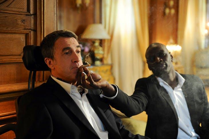 François Cluzet as paraplegic billionaire Philippe and Omar Sy as his carer Driss in Untouchable (2011)