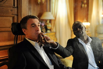 François Cluzet as paraplegic billionaire Philippe and Omar Sy as his carer Driss in Untouchable (2011)