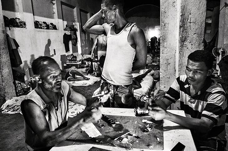 Inmates making crack pipes. Gangmasters run drug and extortion rackets from the inside