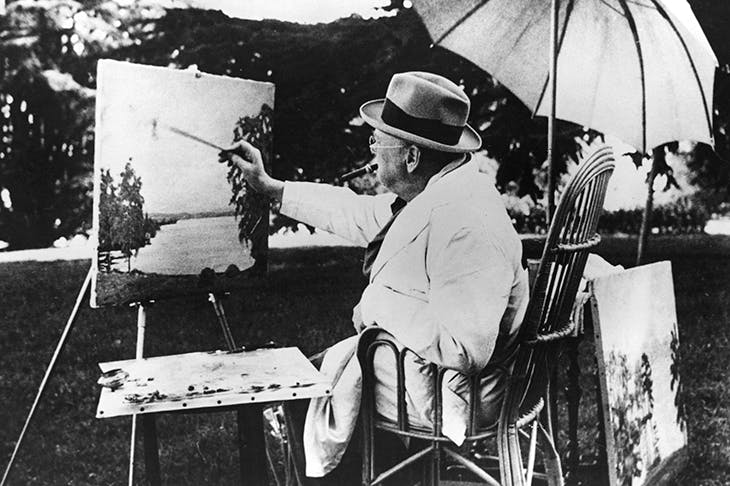 Winston Churchill painting beside Lake Geneva (Photo: Getty)