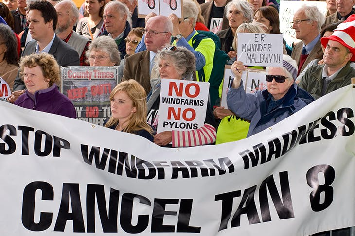 Campaigners protest against government plans to build huge new windfarms in Wales in 2011. Credit Getty Images