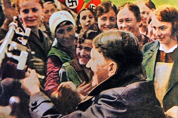 Female Nazi supporters greet Hitler after his election as chancellor in 1933. Credit: Getty Images