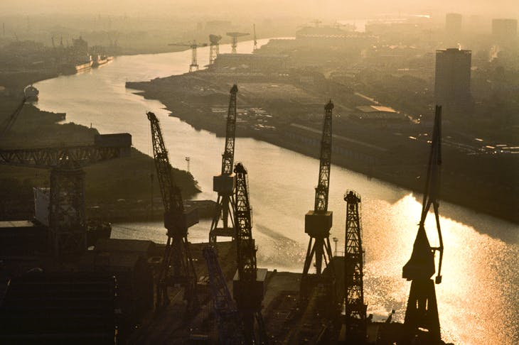 Sunset on the Clyde, 1984. The massive cranes used to build the Lusitania, HMS Hood, the Queen Mary and the QE2 are relics of the once great maritime industry of Port Glasgow