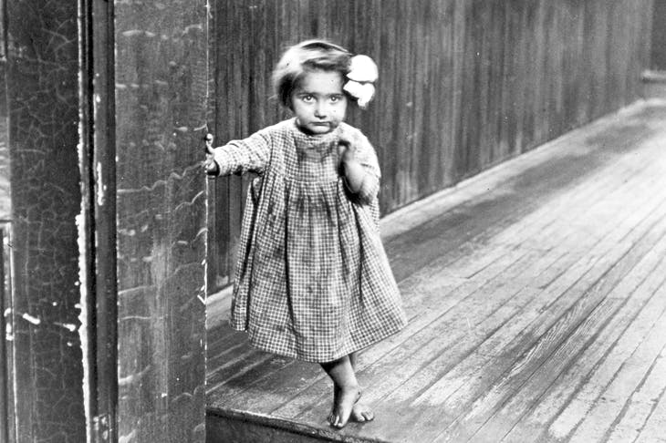 Photograph of an almshouse waif by Lewis W. Hine, entitled 'Little Orphan Annie in a Pittsburg Institution' (1909) [Bridgeman Art Library]