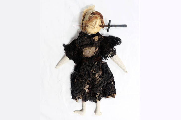 Stuffed doll in Edwardian-style black dress with stiletto through face, south Devon, England , 1909–13