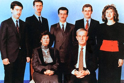 Former Syrian President Hafez al-Assad and his wife Anisa with his children (l-r) Maher, Bashar, Bassel, Majd and Bushra. Photo: Louai Beshara/ AFP/ Getty Images