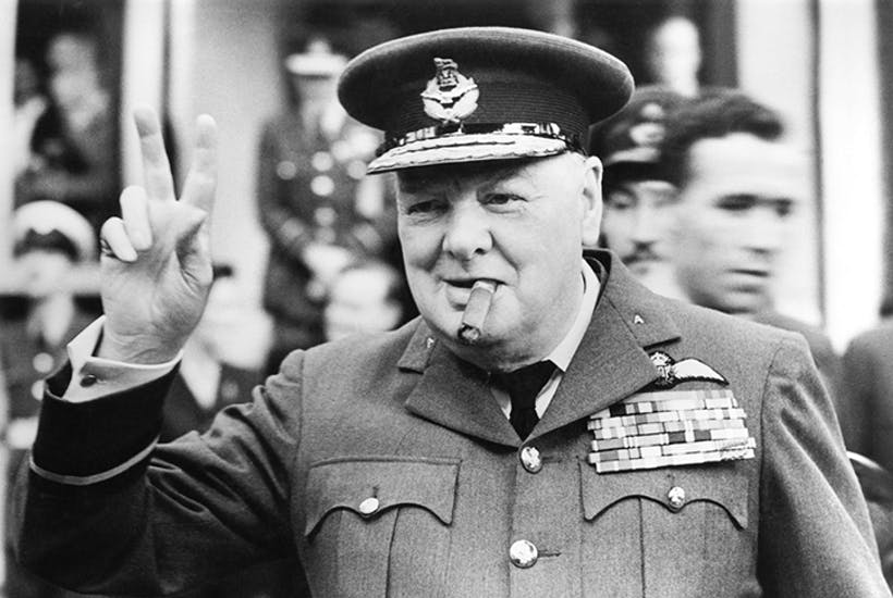 Giving the famous V-sign at the opening of RAAF headquarters, Croydon, 1948 [Getty]