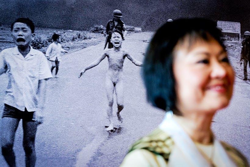 Kim Phuc Phan Thi – Napalm Girl – stands in front of the iconic 1972 photograph that changed public opinion worldwide