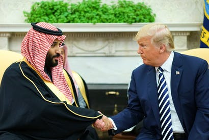 US President Donald Trump shakes hands with Saudi Arabia's Crown Prince Mohammed bin Salman in the Oval Office of the White House, March