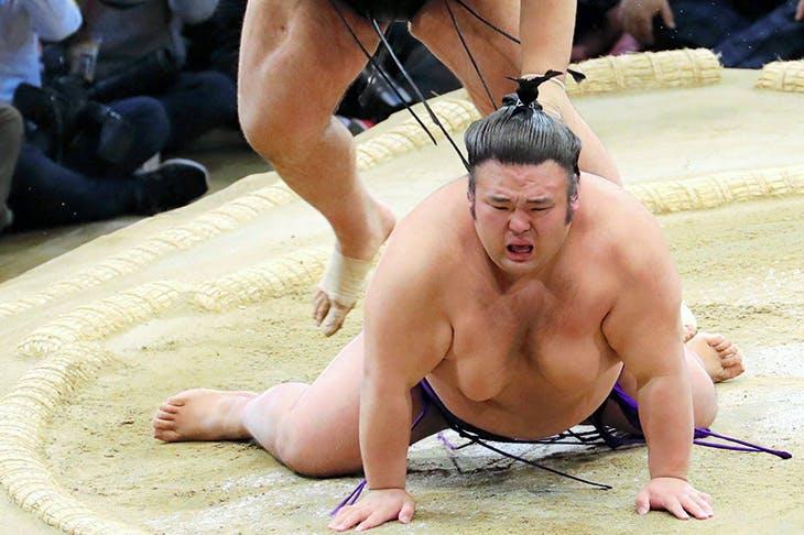 Pounds of flesh: Takayasu throws Takakeisho to the ground to win the 2018 Kyushu tournament in Fukuoka