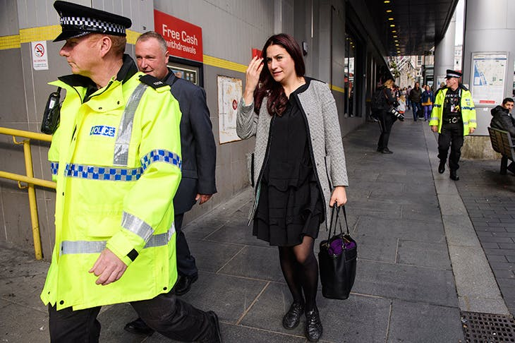 Luciana Berger is escorted by police to Labour's party conference last year after anti-Semitic attacks on Twitter [GETTY IMAGES]