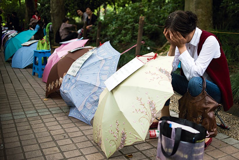 A woman advertises for a partner for her child in Shanghai's People's Park