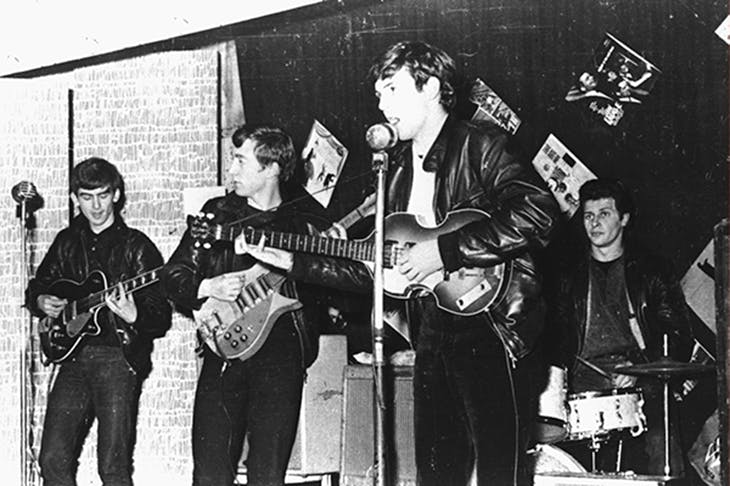 The Beatles perform in Liverpool prior to signing their first recording contract: George Harrison, John Lennon, Paul McCartney, and original drummer Pete Best. Photo: Hulton Archive / Getty Images