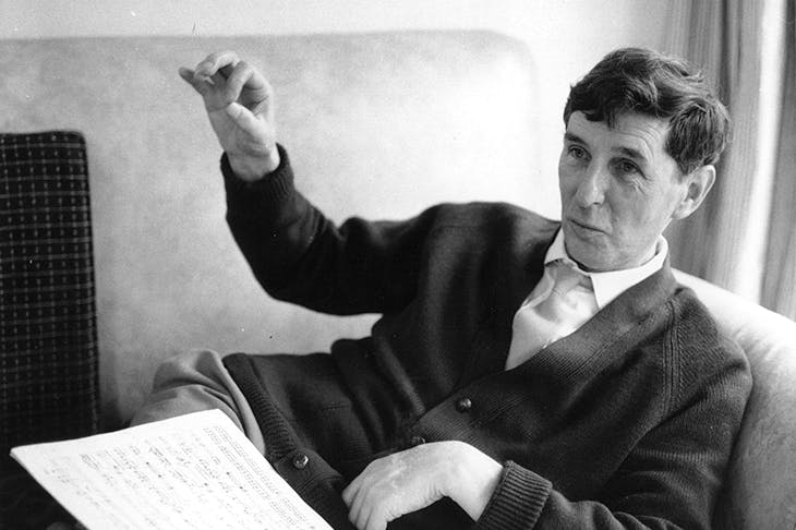 Michael Tippett at home at Parkside, Corsham, Wilts with the score of his second piano sonata