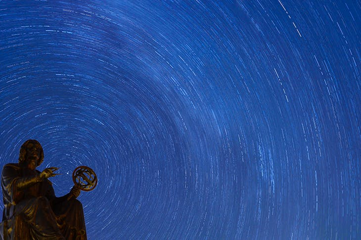Stars rotate behind the Copernicus Monument in Chicago. Credit: Getty Images