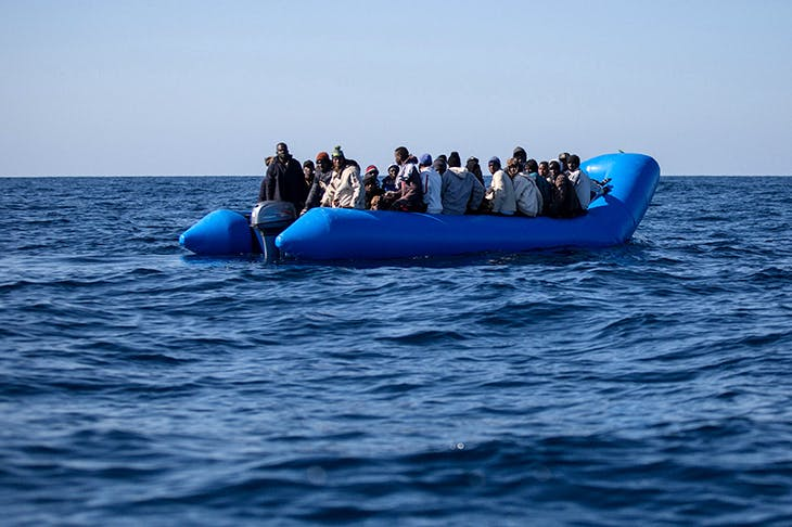 An inflatable boat with 47 migrants is rescued off Libya's coast in January 2019. Credit: Getty Images